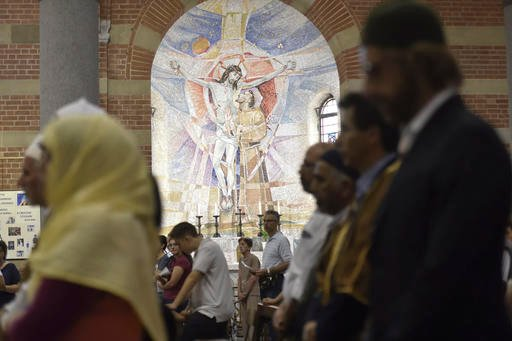 Muslims attend a Mass in Milan's Santa Maria in Caravaggio church, Italy, Sunday, July 31, 2016. Imams and practicing Muslims attended Mass across Italy, from Palermo in the south to Milan in the north, in a sign of solidarity after the France church atta