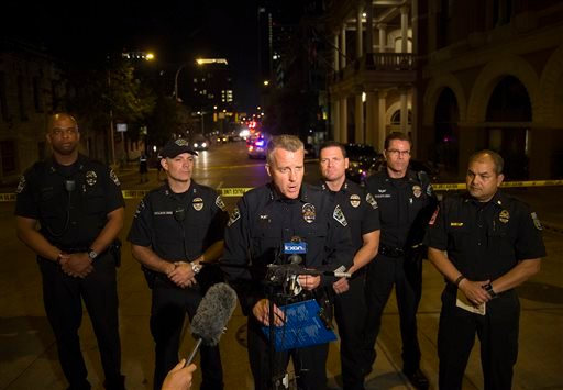 Austin Police Assistant Chief Brian Manley speaks during a press conference after gunshots rang out on Sixth Street just as the bars were emptying at closing time early Sunday, July 31, 2016, leaving one woman dead and several others wounded, and police s