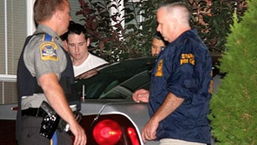 Raymond Clark III, 24, center, is escorted out of an apartment building by police on Tuesday Sept. 15, 2009 in Middletown, Conn. Police on Tuesday raided the apartment of Raymond Clark III, a man they call a person of interest in the slaying of Yale gradu