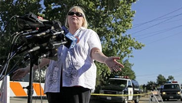 Sharon Murch, whose daughter Michaela Garecht was kidnapped over twenty years ago, gestures during a news conference near the home of Phillip Garrido in Antioch, Calif., Tuesday, Sept. 15, 2009. Police investigating two child abductions in the 1980s searc