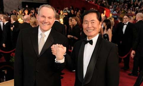 FILE - In this Feb. 22, 2009 file photo, actor George Takei, right, and Brad Altman arrive for the 81st Academy Awards in the Hollywood section of Los Angeles. (AP Photo/Chris Pizzello, file)