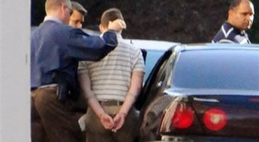 Police officers arrest Raymond Clark III, center, at a motel in Cromwell, Conn., on Thursday, Sept. 17, 2009, for the killing of Yale graduate student Annie Le.