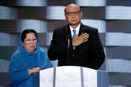 In this Thursday, July 28, 2016 file photo, Khizr Khan, father of fallen US Army Capt. Humayun S. M. Khan and his wife Ghazala speak during the final day of the Democratic National Convention in Philadelphia. Republican presidential nominee Donald Trump b