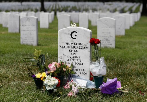 The tombstone of US Army Capt. Humayun S. M. Khan is seen in Section 60 at Arlington National Cemetery in Arlington, Va., Monday, Aug. 1, 2016. Fellow Republicans are joining the rising chorus of criticism of Donald Trump for his disparagement of the bere