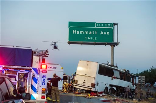 Rescue crews respond to the scene of a charter bus crash on northbound Highway 99 between Atwater and Livingston, Calif.