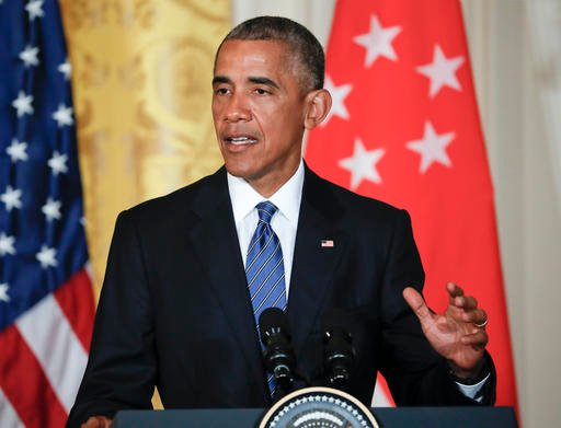 President Barack Obama speak during a joint news conference with Singapore's Prime Minister Lee Hsien Loong in the East Room of the White House in Washington, Tuesday, Aug. 2, 2016.