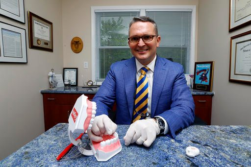 Dr. Wayne Aldredge, president of the American Academy of Periodontology, sits for a photo at his office in Holmdel, N.J. Aldredge acknowledges the weak scientific evidence and the brief duration of many studies on flossing, but says that the impact of flo