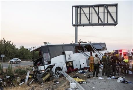 A charter bus veered off a central California freeway before dawn Tuesday and struck a pole that sliced the vehicle nearly in half. (Andrew Kuhn/Merced Sun-Star via AP)