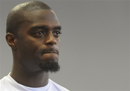 Former Super Bowl star Plaxico Burress appears before judge Michael Melkonian for his sentencing in Manhattan criminal court, Tuesday, Sept. 22, 2009, in New York. Burress was sentenced Tuesday to two years in prison.