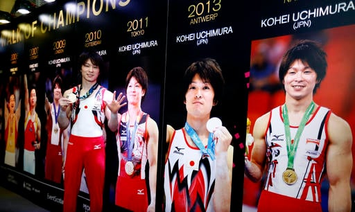 Oct. 30, 2015 file photo: Japan's Kohei Uchimura poses in the Walk of Champions with his sixth gold medal after winning at the World Artistic Gymnastics championships in Glasgow, Scotland. (AP Photo/Matthias Schrader, File)