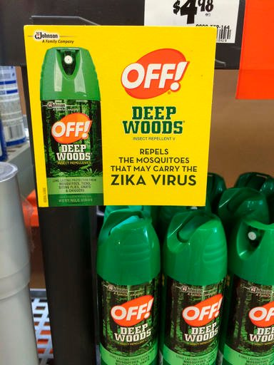 """This July 15, 2015 photo shows a display for cans of Off! insect repellent with a sign which reads, """"Repels the mosquitos that may carry the Zika virus"""""""