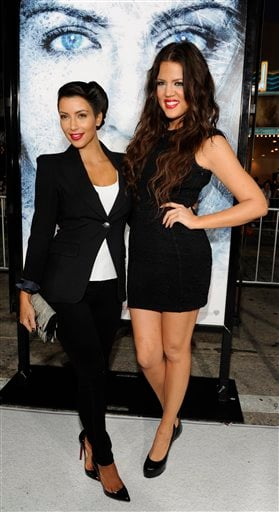 """Kim Kardashian, left, and sister Khloe pose together at the premiere of the film """"Whiteout"""" in Los Angeles, Wednesday, Sept. 9, 2009. (AP Photo/Chris Pizzello)"""