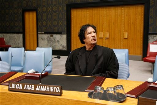 In this photo released by the United Nations, Libyan leader Moammar Gadhafi visits the United Nations Headquarters in New York on Tuesday, Sept. 22, 2009. (AP Photo/The United Nations, Evan Schneider)
