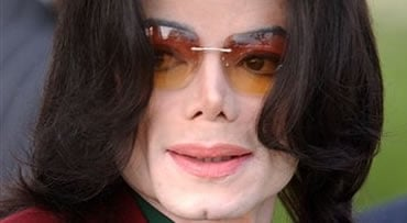 In this March 17, 2005 file photo, pop star Michael Jackson arrives at the Santa Barbara County Courthouse in Santa Maria, Calif. (AP Photo/Michael A. Mariant, file)