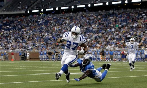 Indianapolis Colts running back Lance Ball rushes for a touchdown during the fourth quarter of a exhibition NFL football game at Ford Field in Detroit. So far, only Jacksonville has had its home opener blacked out. (AP Photo/Paul Sancya)
