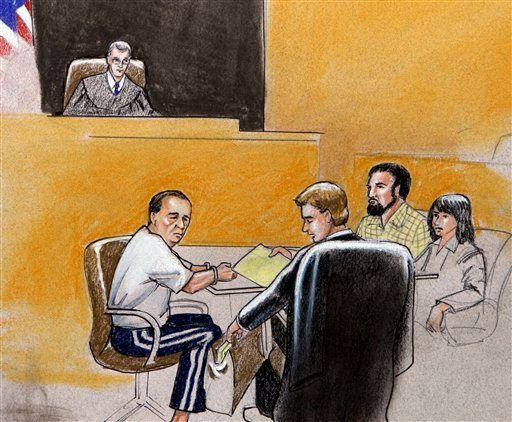 This courtroom drawing shows U.S. Magistrate Judge Craig Shaffer, top, presiding over a hearing in federal court in Denver, on Monday, Sept. 21, 2009, for Najibullah Zazi and his father Mohammad Zazi. (AP Photo/Jeff Kandby)