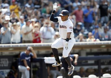 San Diego Padres third baseman Yangervis Solarte leaps in the air after hitting a two-run homer during the sixth inning of a baseball game against the Milwaukee Brewers, Wednesday, Aug. 3, 2016, in San Diego. (AP Photo/Ryan Kang)