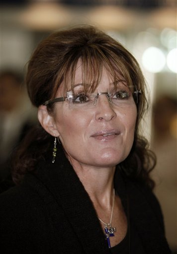 FILE- This Sept. 24, 2009 file photo shows former U.S. vice presidential nominee Sarah Palin arriving at the check-in counter at Hong Kong airport. Palin has finished her memoir just four months after the book deal was announced.