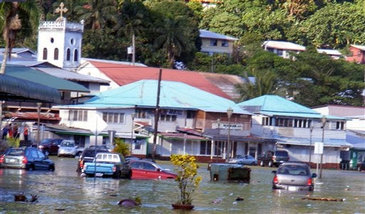 A main road in the downtown area of Fagatogo, is seen flooded by water from a tsunami located in the main town area in American Samoa on Tuesday, Sept. 29, 2009. Towering tsunami waves spawned by a powerful earthquake swept ashore on Samoa.