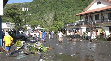 People walk through debris following a powerful quake, in Pago Pago village, on American Samoa Tuesday, Sept. 29, 2009.