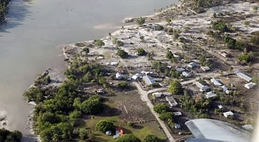 This photo shows an aerial view of Hihifo on the western side of Tonga Tuesday Sept. 29 2009. A powerful quake in the South Pacific hurled massive tsunami waves at the shores of Samoa, American Samoa and Tonga flattening villages and sweeping cars and peo