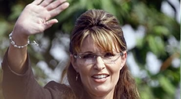 FILE - In this file photo taken Sunday, July 26, 2009, Alaska Gov. Sarah Palin waives goodbye to supporters after giving her resignation speech during a ceremony in Fairbanks, Alaska, where Palin turned over power to Lt. Gov. Sean Parnell. Former vice pre