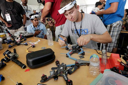 Competitor Tyler Brennan, a 22-year-old Air Force lieutenant from Colorado Springs, Colo., works on a quad copter.