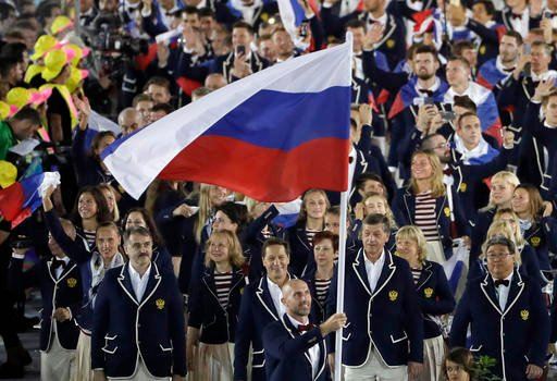 Sergei Tetiukhin carries the flag of Russia during the opening ceremony for the 2016 Summer Olympics in Rio de Janeiro, Brazil, Friday, Aug. 5, 2016. (AP Photo/Matt Slocum)