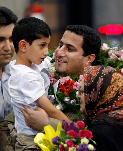 In this July 15, 2010 file photo, Shahram Amiri, an Iranian nuclear scientist greets his son Amir Hossein as he arrives to the Imam Khomeini airport after returning from the United States, outside Tehran, Iran. Amiri, who was caught up in a real-life U.S.