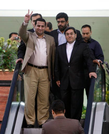 In this July 15, 2010 file photo, Shahram Amiri, an Iranian nuclear scientist flashes a victory sign as he arrives to the Imam Khomeini airport just outside Tehran, Iran, from the United States. Amiri, who was caught up in a real-life U.S. spy mystery an
