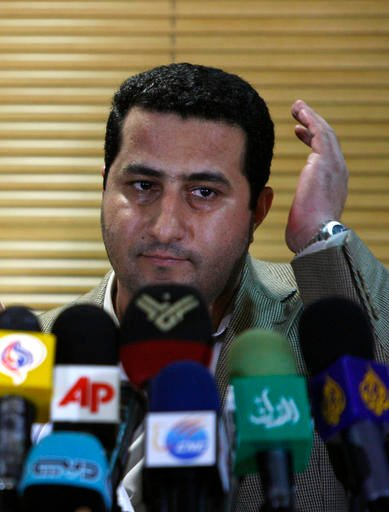 In this July 15, 2010 photo, Shahram Amiri, an Iranian nuclear scientist speaks with journalists at the Imam Khomeini airport, just outside Tehran, Iran, after returning to his homeland from the United States. Amiri, an Iranian nuclear scientist caught up