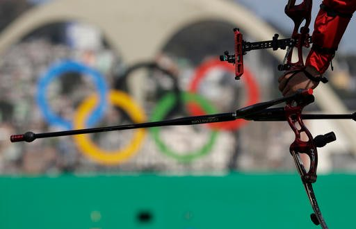 A Chinese archer waits for his turn during the men's team archery competition at the Sambadrome venue during the 2016 Summer Olympics in Rio de Janeiro, Brazil, Saturday, Aug. 6, 2016. (AP Photo/Alessandra Tarantino)