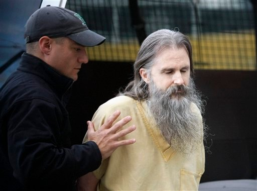 Brian David Mitchell arrives is escorted to the Salt Lake City federal courthouse for a hearing Thursday, Oct. 1 2009, in Salt Lake City. (AP Photo/Colin Braley)