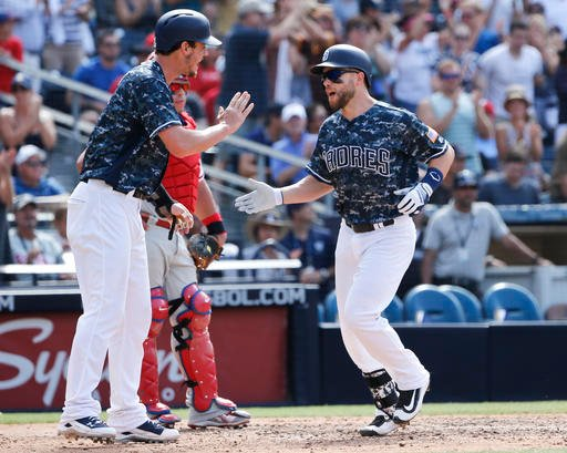San Diego Padres' Ryan Schimpf is met by Wil Myers at home plate after homering against the Philadelphia Phillies in the sixth inning of a baseball game, Sunday, Aug. 7, 2016, in San Diego. (AP Photo/Lenny Ignelzi)