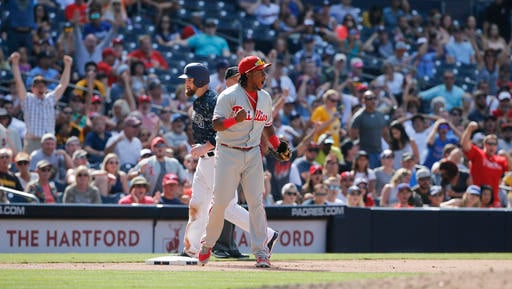 Philadelphia Phillies third baseman Maikel Franco, center front, reacts to a Phillies triple play against the San Diego Padres in the seventh inning of a baseball game Sunday, Aug. 7, 2016, in San Diego. Padres' Derek Norris, center back, looks on. (AP Ph