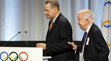 Juan Antonio Samaranch, the former IOC president, right, holds onto the arm of current IOC President Jacques Rogge during the Madrid 2016 bid presentation during the 121st International Olympic Committee session at the Bella Center in Copenhagen, Friday,