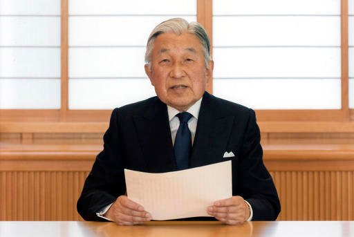 In this photo taken Sunday, Aug. 7, 2016 and provided by the Imperial Household Agency of Japan on Monday, Aug. 8, 2016, Japan's Emperor Akihito reads a message for recording at the Imperial Palace in Tokyo.