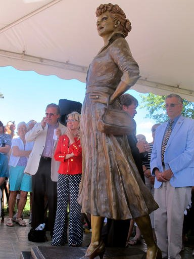 People gather at the unveiling of the new Lucille Ball statue at Memorial Park in Celoron, N.Y: the late actress's home town, Saturday, Aug. 6, 2016.