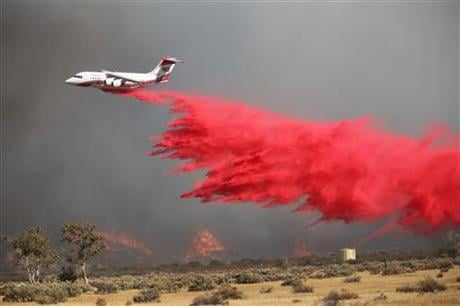 The fire is burning about 55 miles east of Los Angeles in a remote area near Silverwood Lake, a state recreation area, near the small mountain community of Crestline. (John M. Blodgett /The Inland Valley Daily Bulletin via AP)