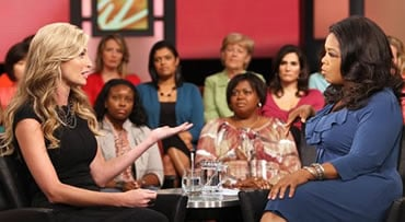 FILE- In this Thursday, Aug. 27, 2009 file photo, photo provided by Harpo Productions, ESPN college football sideline reporter Erin Andrews, left, talks with television talk-show host Oprah Winfrey during a taping for an upcoming showin Chicago. In the in