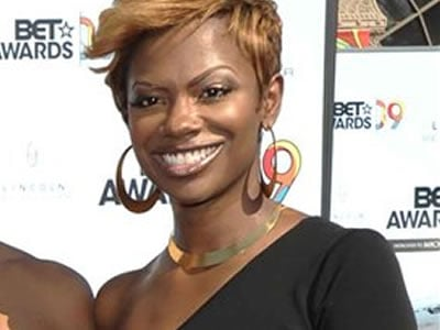 """FILE - In this June 28, 2009 file photo, Kandi Burruss poses as she arrives at the 9th Annual BET Awards in Los Angeles. The former fiance of the cast member from """"The Real Housewives of Atlanta"""" died Friday, Oct. 2, 2009 after a fight outside an Atlanta"""