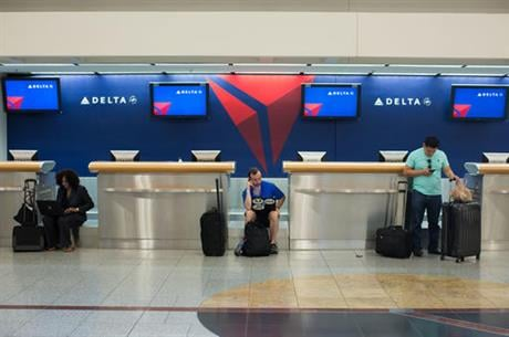Delta Air Lines delayed or canceled hundreds of flights Monday after its computer systems crashed, stranding thousands of people on a busy travel day. (AP Photo/Branden Camp)