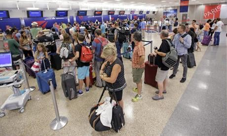Delta Air Lines delayed or canceled hundreds of flights Monday after its computer systems crashed, stranding thousands of people on a busy travel day. (AP Photo/Rick Bowmer)