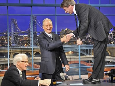 "In this publicity image released by CBS, Steve Martin, left, is seated as Martin Short shakes hands with host David Letterman, center, during a taping of ""The Late Show with David Letterman,"" on Monday, Oct. 5, 2009, in New York. (AP Photo/CBS, John Paul"