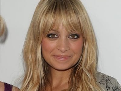 FILE - In this Thursday, August 6, 2009 picture, television personality Nicole Richie poses at the launch of her maternity clothing line hosted in Beverly Hills, Calif. Police say reality Richie has been hurt in a traffic accident in Beverly Hills. Beverl