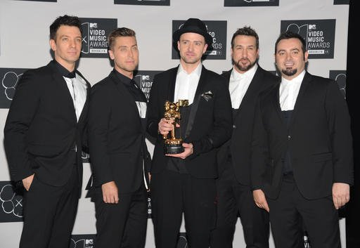In this Aug. 25, 2013, file photo, Justin Timberlake, center, winner of the video vanguard award poses backstage with, from left, JC Chasez, Lance Bass, Joey Fatone and Chris Kirkpatrick of NSYNC at the MTV Video Music Awards.
