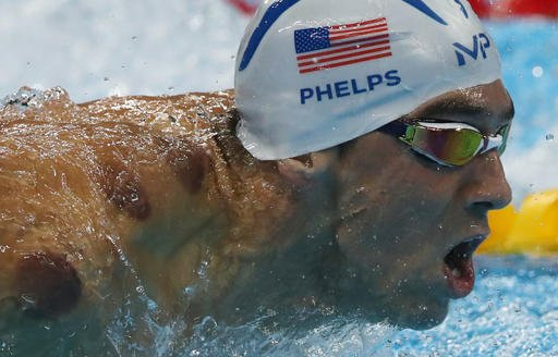 United States' Michael Phelps competes in a heat of the men's 200-meter butterfly during the swimming competitions at the 2016 Summer Olympics, Monday, Aug. 8, 2016, in Rio de Janeiro, Brazil. (AP Photo/Lee Jin-man)