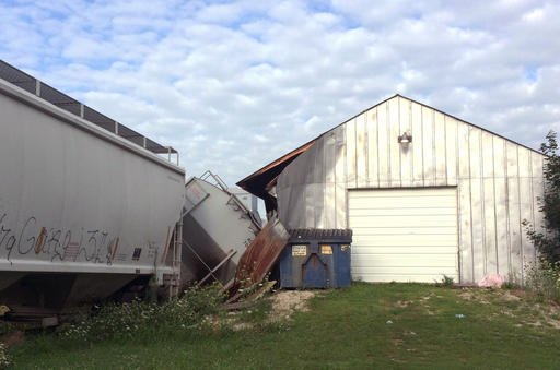 A freight train car that derailed in Charles City, in northern Iowa, derailed into and damaged a trackside tavern called DeRailed early Tuesday, Aug. 9, 2016.