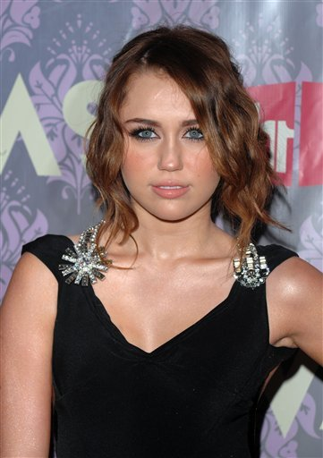 FILE - In this Sept. 17, 2009 file photo, recording artist Miley Cyrus arrives at VH1 Divas concert in New York. (AP Photo/Peter Kramer, file)