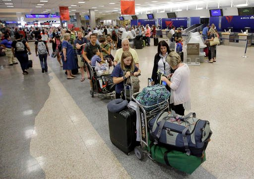Delta passengers stand in line as the carrier slogged through day two of its recovery from a global computer outage at Salt Lake City International Airport.